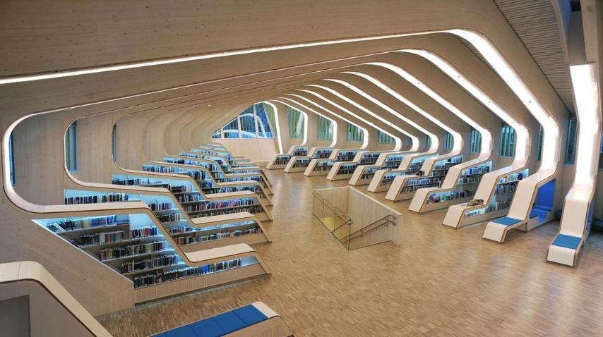 Per la loro nuova biblioteca e il centro sociale in Vennesla, gli architetti norvegesi Helen & Hard portano una sofisticata eleganza alla struttura pubblica in Norvegia: struttura in legno scatolare all'esterno, grande organicità degli spazi interni contemporanei.