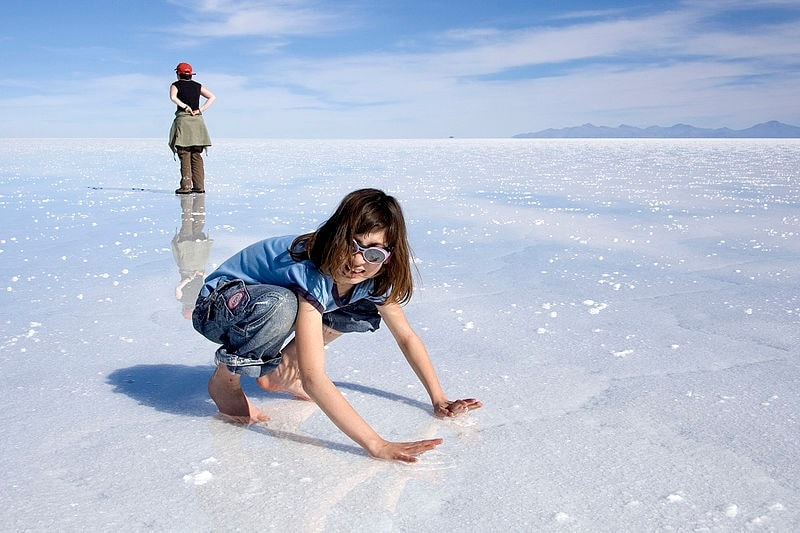 http://commons.wikimedia.org/wiki/File:Giulia_on_wet_Salar_de_Uyuni_Bolivia_Luca_Galuzzi_2006.jpg