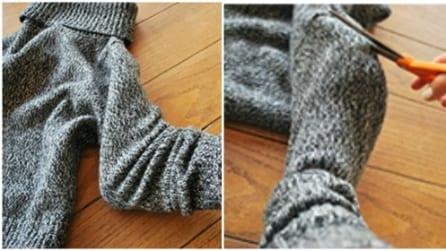 Taglia le maniche di un vecchio maglione e le trasforma in modo geniale