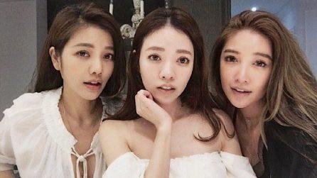 Tre bellissime ragazze posano per una foto, ma un dettaglio trae tutti in inganno
