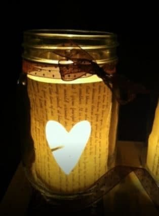 Cut a heart on paper and paste it in the jar, then put a candle.