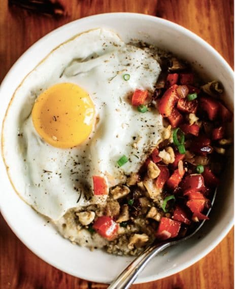 Cheddar, eggs and oatmeal savory. Credit: https://healthynibblesandbits.com/savory-oatmeal-cheddar-and-fried-egg/