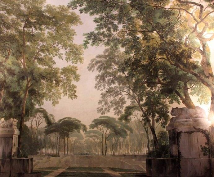 """Al pianterreno di Palazzo Hercolani, questo giardino d'inverno è l'esempio più innovativo, a Bologna, delle """"stanze paese"""" neoclassiche, dipinte con paesaggi e vegetazione che simulano l'ambiente naturale"""