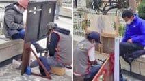 Barriera di legno per mantenere il distanziamento sociale: anche i lustrascarpe tornano al lavoro