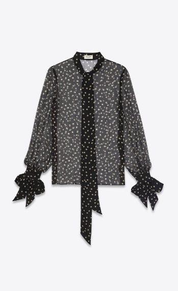Blusa trasparente nera con polsini svolazzanti e stampa a pois