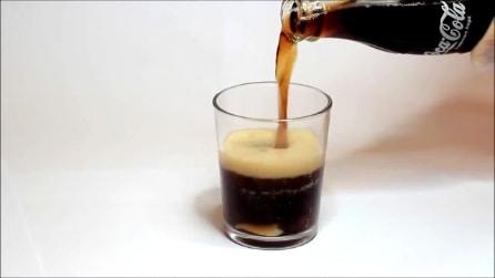 Ecco cosa accade se lasci un dente in un bicchiere di coca cola per 24 ore