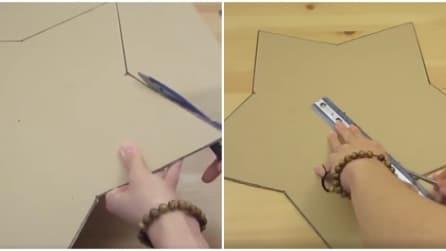 Ritaglia un vecchio cartone a forma di stella e realizza qualcosa di originale per la stanza