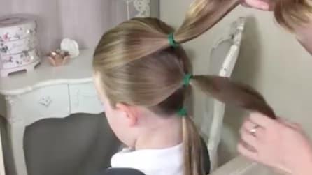 Lega i capelli in tre piccole code di cavallo: il risultato vi lascerà a bocca aperta