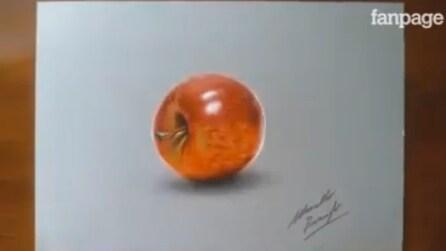 Sembra una mela vera e invece è un disegno: è opera di un artista italiano