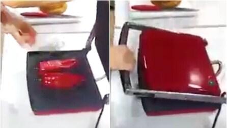Peperoncini rossi in una griglia elettrica, il motivo è davvero ghiotto