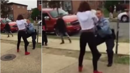 La poliziotta si avvicina alla ragazza di colore e quello che fa è incredibile