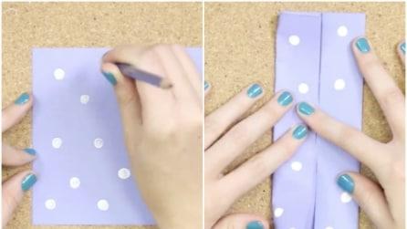 Come realizzare un fiocco di carta con l'origami