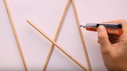 Come fare un puntale a stella per l'albero di Natale con legno e filo