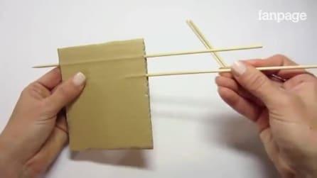 Coloca os palitos no papelão: o que ele faz é genial