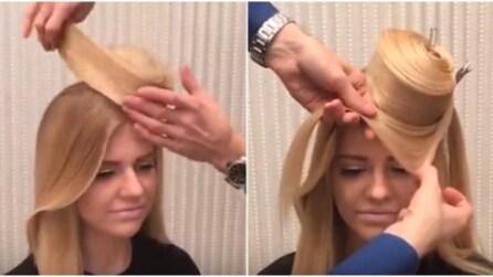 Avvolge i capelli in questo modo: quello che realizza è un vero capolavoro
