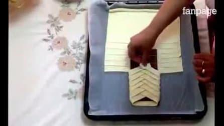 Ela envolve uma barra de chocolate em massa folhada: o resultado é genial