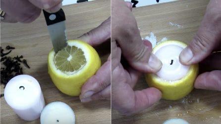 Spolpa un limone e mette all'interno una candela: il rimedio fai da te contro le zanzare