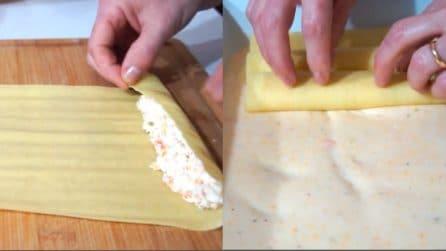 Farcisce i cannelloni e li poggia su un letto di besciamella: un primo piatto unico