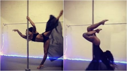 Volteggia con eleganza aggrappata al palo: la ballerina vi incanterà con la sua danza sensuale