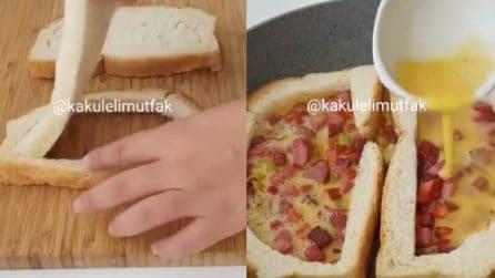 Rimuove la mollica del pane, poi farcisce tutto nella padella: la frittata gustosa da provare
