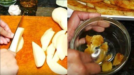 Taglia verticalmente le patate e prepara un cremina con l'aglio: un contorno semplice e squisito