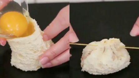 """Mette il tuorlo d'uovo in un """"sacchetto"""" di pasta: l'idea sfiziosa per l'antipasto"""