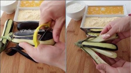 Sbuccia le melanzane e le divide in quattro: un'idea originale e buonissima