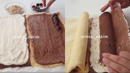 """Farcisce il pan di spagna """"bicolore"""" e lo arrotola: una merenda simpatica e golosa"""