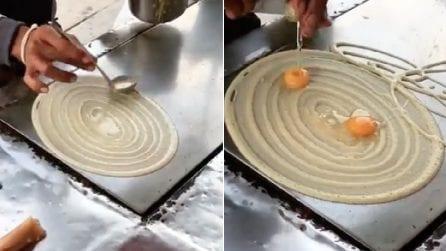 """Crea un """"vortice"""" con la pastella poi versa le uova: il risultato è da acquolina in bocca"""