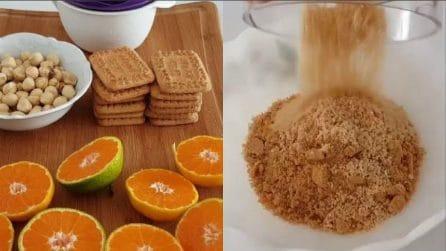 Frulla biscotti e nocciole e prepara dei golosissimi dolcetti all'arancia