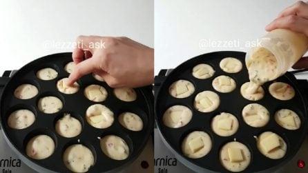 Mette un cubetto di formaggio nell'impasto: prepara delle ottime frittelle