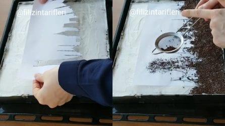 Mette un foglio sulla torta e la decora in maniera originale