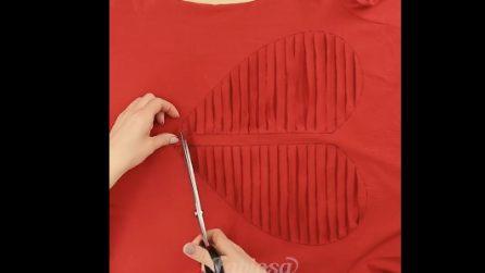 Disegna un cuore sul suo vestito rosso: quello che realizza alla fine è da urlo