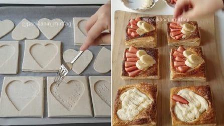 Forma dei cuori di pasta sfoglia e li farcisce: un ricetta golosa e romantica