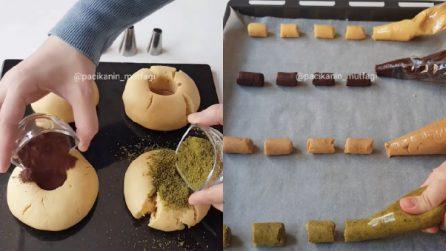 Aggiunge vari ingredienti alla pasta frolla, poi riempie le sac à poche: un'idea da provare