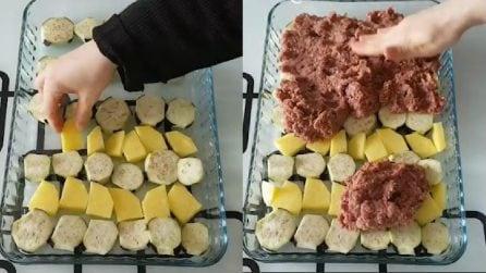 Alterna melanzane e patate, poi le copre con la carne: un piatto squisito