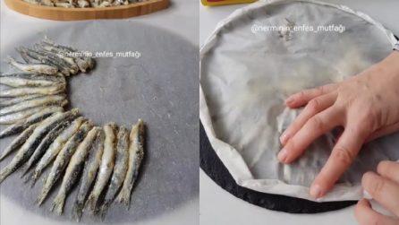 Dispone le alici sulla carta forno e poi le cuoce: un metodo alternativo alla frittura