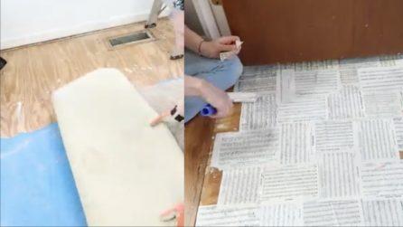 Rimuove la moquette e realizza un pavimento di carta riciclata: l'idea geniale