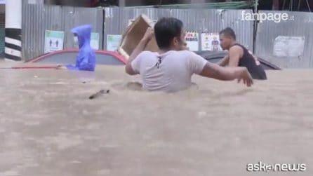 Le immagini della devastante alluvione a Manila