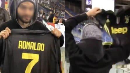 Alla fine di Roma-Real, mostra la maglia della Juve di Cristiano Ronaldo ai tifosi del Real Madrid