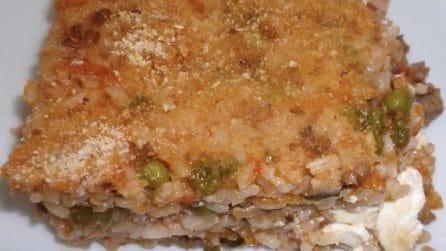 Riso al forno con piselli ricotta e salsiccia: il primo piatto che accontenta tutti