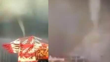 Barcellona, il tornado e l'arcobaleno ripresi dai turisti