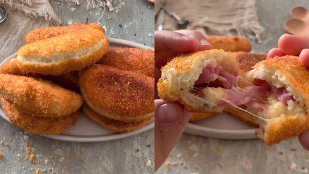 Calzoni ripieni di prosciutto e formaggio: perfetti per una cena semplice e gustosa!